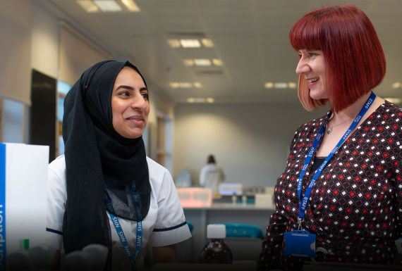 Amina Zaheer, Themis Apprentice, with friendly expert Trainer Assessor in state-of-the-art Burnley College lab